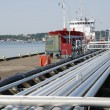 Stock Photo: Pipelines and oil tanker