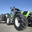 Stock Photo: Giant farming tractor and plough