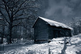 Old barn at night, snow and ice — Stock Photo