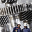Engineers and nuclear machinery — Stock Photo