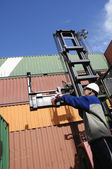 Forklift, containers and worker — Stock Photo