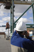 Worker directing container crane — Stock Photo