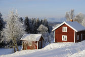 Red cottages in winter time — Stock Photo