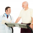 Fit Senior Man Consults Doctor — Stock Photo