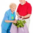 Stock Photo: Healthy Seniors Recycle
