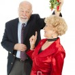 Senior Casanova with Mistletoe - Stock Photo