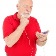 Senior Man Confused by MP3 Player — Stock Photo