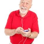 Senior Man with MP3 Player — Stock Photo #6511327