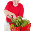 Senior Shopper Checks Basket — Stock Photo #6511343