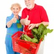 Royalty-Free Stock Photo: Senior Shoppers Give Thumbs Up