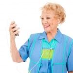 Senior Woman Watching Video — Stock Photo #6511375