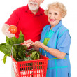 Seniors with Organic Produce - Stock Photo