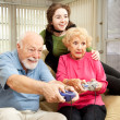 Family Plays Video Games — Stock Photo