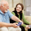 Stock Photo: Grandfather Granddaughter Bonding