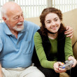 Grandpa Bonds with Teen - Stock Photo