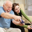 Grandpa and Teen Play Video Games — Stock Photo