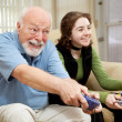 Senior Man Playing Video Games - Foto Stock