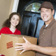 Friendly Delivery Guy and Customer - Stock Photo