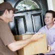 Man Receives Package Delivery — Stock Photo #6515629