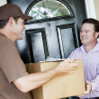 Man Receives Package Delivery - Stok fotoğraf