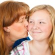 Mom Kisses Teen Daughter — Stock Photo
