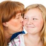 Mom Kisses Teen Daughter — Stock Photo