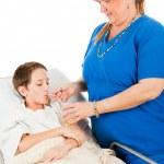 Постер, плакат: Nurse Administers Fluids