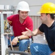 Stock Photo: AC Technicians Discuss Problem