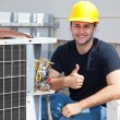 Air Condioner Repairman Thumbsup - Stock Photo