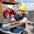 Stock Photo: Apprentice Air Conditioning Repairman