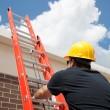 Construction Worker Climbs Ladder — Stock Photo