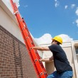 Construction Worker Climbs to Roof — Stock Photo #6516742