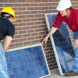 Royalty-Free Stock Photo: Electricians Measure Solar Panels