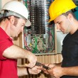 Stock Photo: Electricians Repair Circuit Breaker