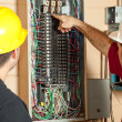 Stock Photo: Electricians Replace 20 Amp Breaker