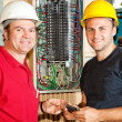 Stock Photo: Friendly Electricians at Work