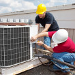 Industrial Air Conditioning Repair - Stock Photo