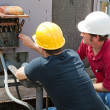 Repairing Industrial Air Conditioner - Stock Photo