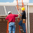 Workers Install Solar Panels - Stock Photo
