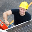 Stock Photo: Electrician Installs Solar Panel