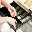 Cashiers Hands Make Change — Stock Photo #6517005