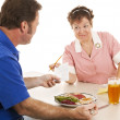 Stock Photo: Waitress Hands Customer the Bill