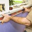 Leveling Drywall - Stock Photo