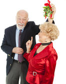 Senior Casanova with Mistletoe — Stock Photo
