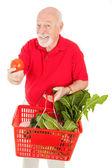 Senior Man Shops for Produce — Stock Photo