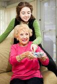 Teen Helps Grandma — Stock Photo