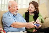 Teen Helps Grandpa — 图库照片