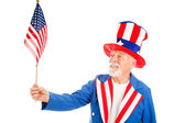 Uncle Sam Holds US Flag — Stock Photo