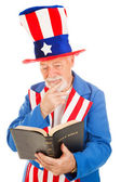 Uncle Sam Reads the Bible — Stock Photo