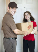 Delivery Man and Satisfied Customer — Stock Photo
